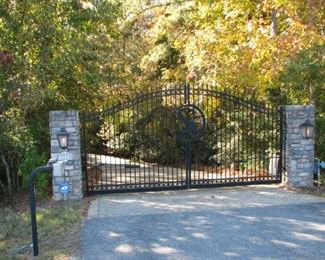 Gated Entry off of Hwy. 59 with keypad and gas lanterns