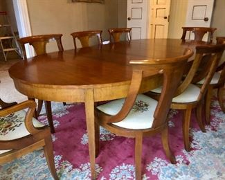 Baker dining room furniture includes table with three leaves, 6 side chairs, 2 arm chairs, China cabinet/curio cabinet sideboard and a beautiful red and sky blue wool rug.