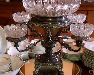 French silver and cut glass epergne shown on one of three mirrored and silver plate plateau
