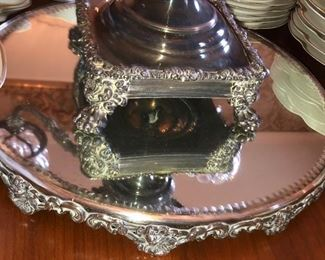 French silver and cut glass epergne shown on one of three mirrored and silver plate plateaus