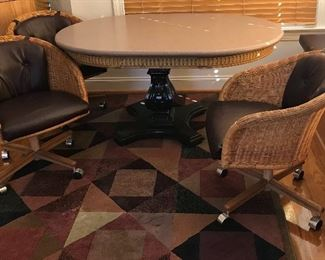 Mid-Century Modern wicker chairs on rollers; pedestal kitchen table w/Corian table top