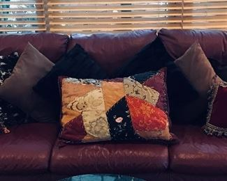 Accent pillows on leather coach
