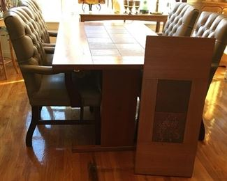 View of MCM dining table with leaf off and standing