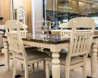 This dining room set is absolutely one of my favorites - perfect even for families!  All vinyl seats and a tabletop that is easy to clean.  LOVE!