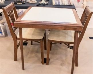 Stakmore card table and two chairs.