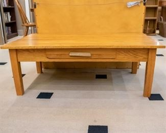 Oak coffee table with drawer.