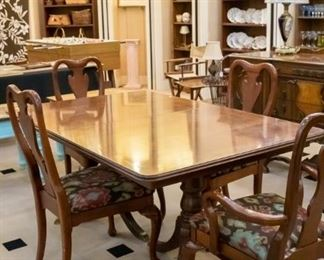 Antique table (and leaf), four chairs.