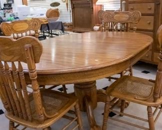 Oak Table/Five Chairs, and table protection covers.