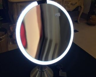 """Simplehuman Sensor Lighted Makup Vanity Mirror. The mirror is 8"""" round with touch control brightness,,  5x's magnification, brushed stainless and is reachable with cable. It's like new."""