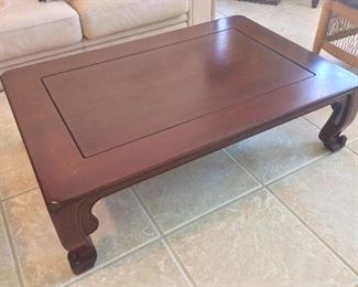 "Rosewood Table, 47"" L x 31"" W x 14"" H."
