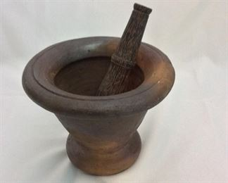"Thailand Mortar 6 1/2"" H and Pestle 7 1/2"" L."