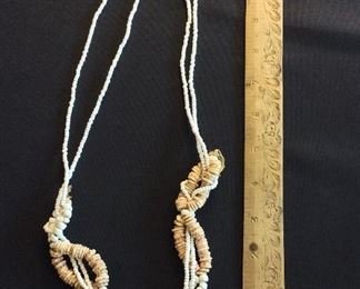 Long Strands of Ostrich Shell Beads of various sizes.