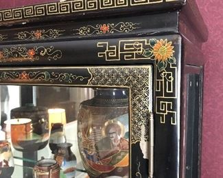 Asian China / Display cabinet. Measures 39 1/4 inches across 67 and three-quarter inches tall and 16 1/2 inches deep.