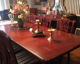 This gorgeous dining table will comfortably seat 12 or more.