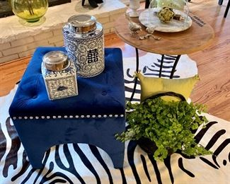 Outstanding collection of home decor items! Seen here, plush velvet blue ottoman, fauz zebra throw, wine barrel top-turned-to-table.