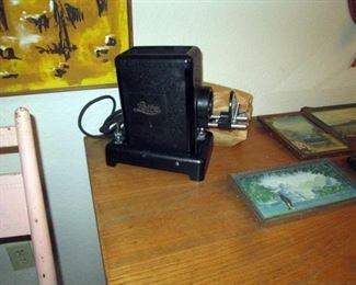 Kitchen Area:  Vintage Lietz Projector, Several piecrust framed tinted photographs (Snoqualmie Cascade mountain stream, Mt. Edgecumbe, Sitka Alaska)