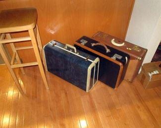 Kitchen Area:  Tall Stool, 3 Vintage Suitcases