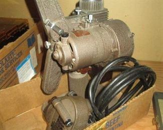 Garage:  Revere 8 mm Projector & 8mm Movie Camera