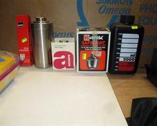 Garage:  Sponge Tongs, Accura Stainless Develop Tank (2 Rolls), Accura Stainless Develop Tank (4 Rolls), Kustom Safelight for Darkroom (Works), Empty Black Bottle