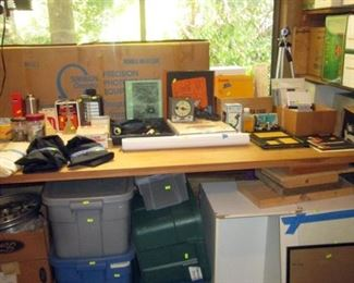 Garage:  Dark Room Stuff:  Simon Omega Enlarger w/Lens, Aluminium Spacers, Box of Tinted Lens, 2 Half-Moon Thick glass pieces, Extra Lens  Sponge Tongs, Accura Stainless Develop Tank (2 Rolls), Accura Stainless Develop Tank (4 Rolls), Kustom Safelight for Darkroom (Works), Empty Black Bottle  Accura Stainless Develop Tank (2 Rolls)
