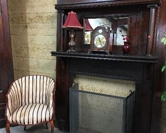 Antique fireplace mantle, Striped accent Chair, Mantle clock
