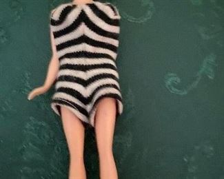 WHAT A FIND..Bild Lili 7.5 Inches Doll. She is wearing a regular Vintage B/W Striped Swimsuit..she only has 1 arm. Hair is Blonde Ponytail. Hong Kong, British Patent