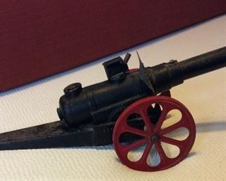 "Big Bang Cast Iron Toy Cannon, 24"" L."