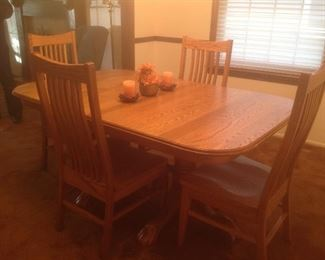 "Amish solid oak dining table.  Has four leaves inside table and ten chairs.  Measures 65l x 42w x 30""t.  Presale with Hutch is $2600"