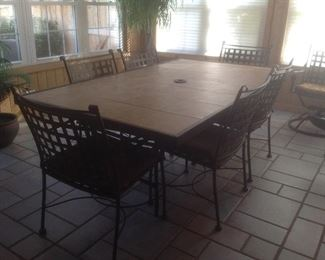 "Big outdoor table with eight chairs.  7' x 4' table , chairs are six flat and two swivel.  Matching end table is 20"" square.  Presale at $395"
