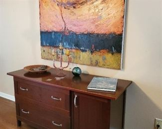 artwork and file cabinet