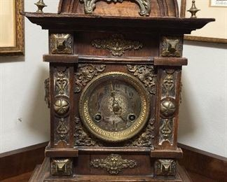 Antique mantel clock with ornate brass accents