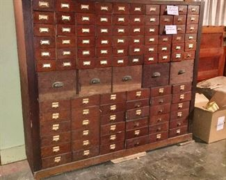 This is a very large wood filing cabinet. There is also a large stamp collection in boxes and inside some of these drawers. We are taking bids on the stamp collection only. The cabinet is priced to sell.