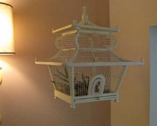 One of two vintage wood bird cages.