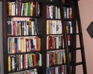 Office / Library wall full of books.