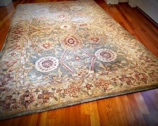 Traditional wool area rug
