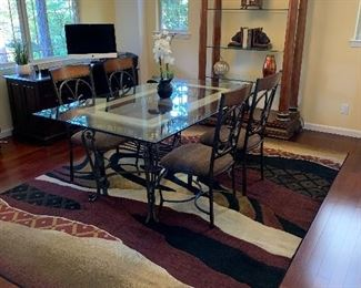 Glass top table with 4 wrought iron chairs