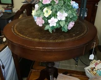 Beautiful round leather top accent table.  Has a faux drawer