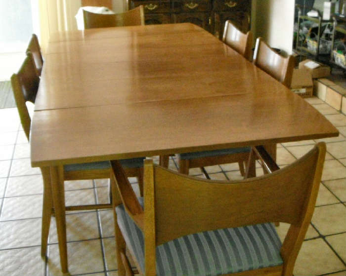 """Danish Mid Century Modern.  8'1"""" X 3'4"""" with all three leaves in.  8 Chairs."""