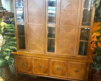 "MCM, 1960's, TEAK, 2-Piece China Cabinet with Beveled Glass, 2 Doors on Top and 4 Doors on Bottom, with Brass ""Boots"" on front legs (3 legs on back), Height-72.5"", Depth-13"" top and 17"" bottom, Width-56"" top and 60"" bottom. (Appraised Value: $1,200-$1,500)"