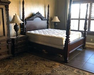 king sized carved wood 4 poster bedroom set-includes bed-2 night stands - armoire -dresser and mirror-just a statement set  think the night stands and dresser   is all wood. -( not stone as i had thought before- sorry on that ).
