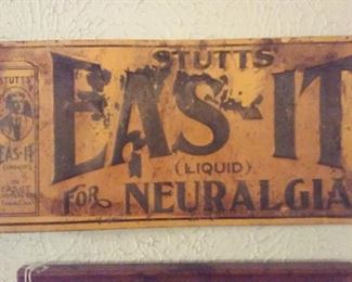 Old early 1900s tin sign for quack medicine Stutt's Eas-It Liquid for Neuralgia.  Dr. Stutts was from Alabama.