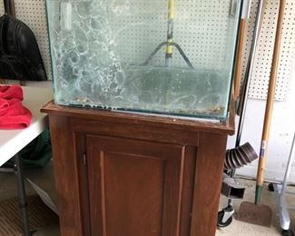 Fish tank and stand (an entire bin full of supplies come with!)