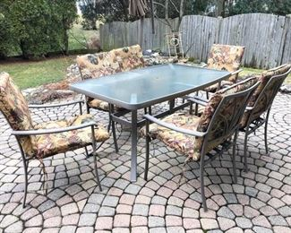 Patio table with 6 chairs shown with chair cushions