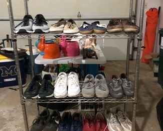 Metal shelving unit and men's shoes