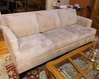 Neutral colored upholstered couch in perfect condition!