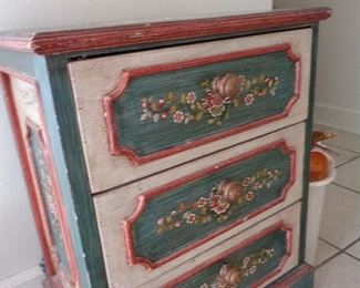love this small distressed cabinet