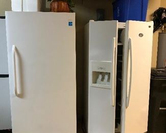 Newer large freezer probably still under warranty and side by side refrigerator