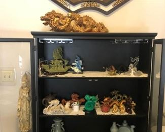 Jade and dragon collection in a Lacquered Show case