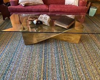The 'twisted wood' coffee table displays a vintage stereoscope and cards