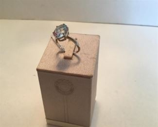Ring blue topaz on 14kt white gold setting 6.5""